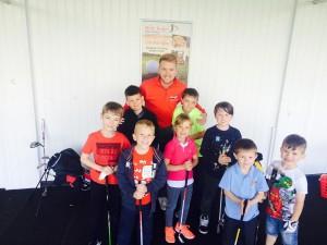 Adam with kids on range